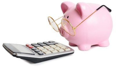 Piggy bank reading a calculator