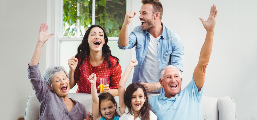 A multi-generational family cheering