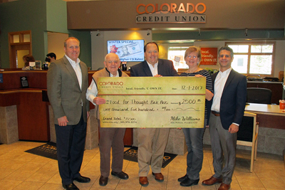 Five people holding up a $2,500 check Colorado Credit Union donated to Food for Thought