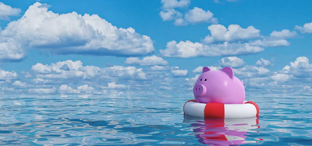 Piggy bank in a floaty in the water.